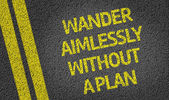 Wander Aimlessly Without a Plan written on the road — Stock Photo