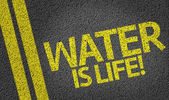 Water Is Life! written on the road — Stock Photo