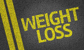 Weight Loss written on the road — Stock Photo