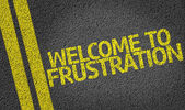 Welcome to Frustration written on the road — Stock Photo