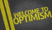 Welcome to Optimism written on the road — Stock Photo