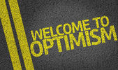 Welcome to Optimism written on the road — Stockfoto