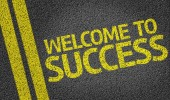 Welcome to Success written on the road — Stock Photo