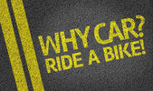 Why Car? Ride a Bike! written on the road — Stock Photo