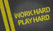Work Hard Play Hard written on the road — Stock Photo