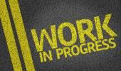 Work In Progress written on the road — Стоковое фото