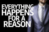 Everything Happens for a Reason written on a board with a business man — Stock Photo