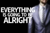 Everything is going to be Alright written on a board with a business man — Stock Photo
