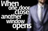 When one door close another window opens written on a board with a business man — Stock Photo
