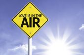 Love is in the Air road sign — Stock Photo