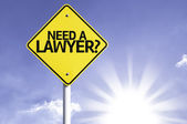 Need a Lawyer?    road sign — Stock Photo