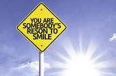 You Are Somebody's Reason to Smile road sign — Stock Photo