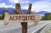 Acredite  wooden sign — Stock Photo