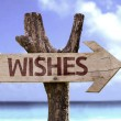 Wishes wooden sign with a landscape background — Stock Photo #54777807