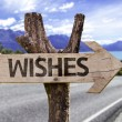 Wishes wooden sign with a landscape background — Stock Photo #54777817