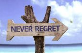 Never Regret wooden sign — Stock Photo