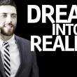 Business man with the text Dream Into Reality in a concept image — Stock Photo #54813379