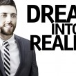 Business man with the text Dream Into Reality in a concept image — Stock Photo #54813389
