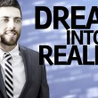 Business man with the text Dream Into Reality in a concept image — Stock Photo #54813411