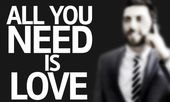 Business man with the text All you Need is Love in a concept image — Stock Photo