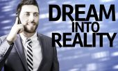 Business man with the text Dream Into Reality in a concept image — Stock Photo