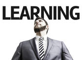 Business man with the text Learning in a concept image — Stock Photo