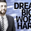 Business man with the text Dream Big Work Hard in a concept image — Stock Photo #54906421