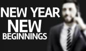 Business man with the text New Year New Beginnings in a concept image — Stock Photo