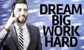 Business man with the text Dream Big Work Hard in a concept image — Photo
