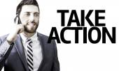 Business man with the text Take Action in a concept image — Stock Photo