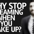 Business man with the text Why Stop Dreaming When You Wake Up? in a concept image — Stock Photo #54981331