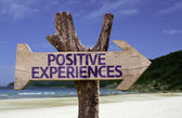 Positive Experiences wooden sign with a beach on background — Stok fotoğraf