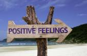Positive Feelings wooden sign with a beach on background — Stok fotoğraf