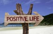 Positive Life wooden sign with a beach on background — 图库照片