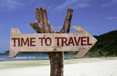 Time to Travel wooden sign with a beach on background — Stock Photo