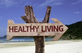 Healthy Living wooden sign with a beach on background — Stock Photo