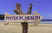 Physical Health wooden sign with a beach on background — Stock Photo