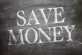 Save Money written on board — Stock Photo