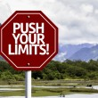 Push your Limits! written on red road sign — Stock Photo #59674087