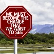 We Must Become The Change That We Want to See written on red road sign — Stock Photo #59674421