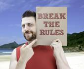 Man holding a card with the text Break The Rules — Stockfoto