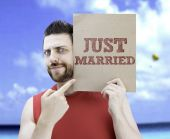 Man holding a card with the text Just Married — Stock Photo