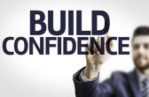 Board with text: Build Confidence — Stock Photo