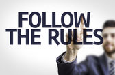 Board with text: Follow the Rules — Foto Stock
