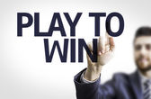 Board with text: Play to Win — Foto de Stock
