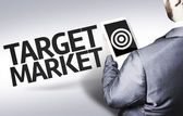 Business man with the text Target Market — Stock Photo
