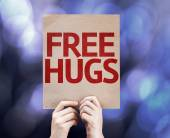 Free Hugs written on colorful background — Stock Photo