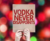 Vodka Never Disappoints written on colorful background — ストック写真