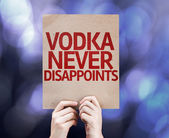 Vodka Never Disappoints written on colorful background — Zdjęcie stockowe