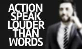 Business man with the text Action Speak Louder Than Words — Stock Photo
